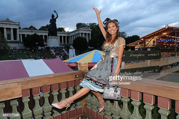 Cathy Hummels wearing a dirndl by Lola Paltinger during the Oktoberfest 2015 Opening at Kaeferschaenke beer tent at Theresienwiese on September 19...