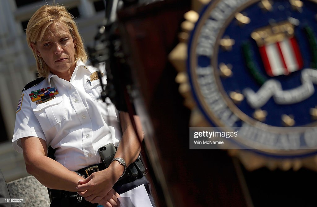 Cathy Lanier, Chief, Metropolitan Police Department listens to questions from reporters on the Washington Navy Yard shooting during a briefing outside the FBI Field Office September 25, 2013 in Washington, DC. The FBI today released surveillance footage of Washington Navy Yard shooter Aaron Alexis at the scene of last weekÕs crime, and other photographic evidence used in the investigation.