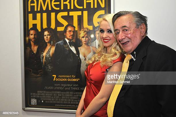 Cathy Lugner and Richard Lugner pose for a photograph at the after party for the Austrian premiere of 'American Hustle' at Lugner Lounge on February...