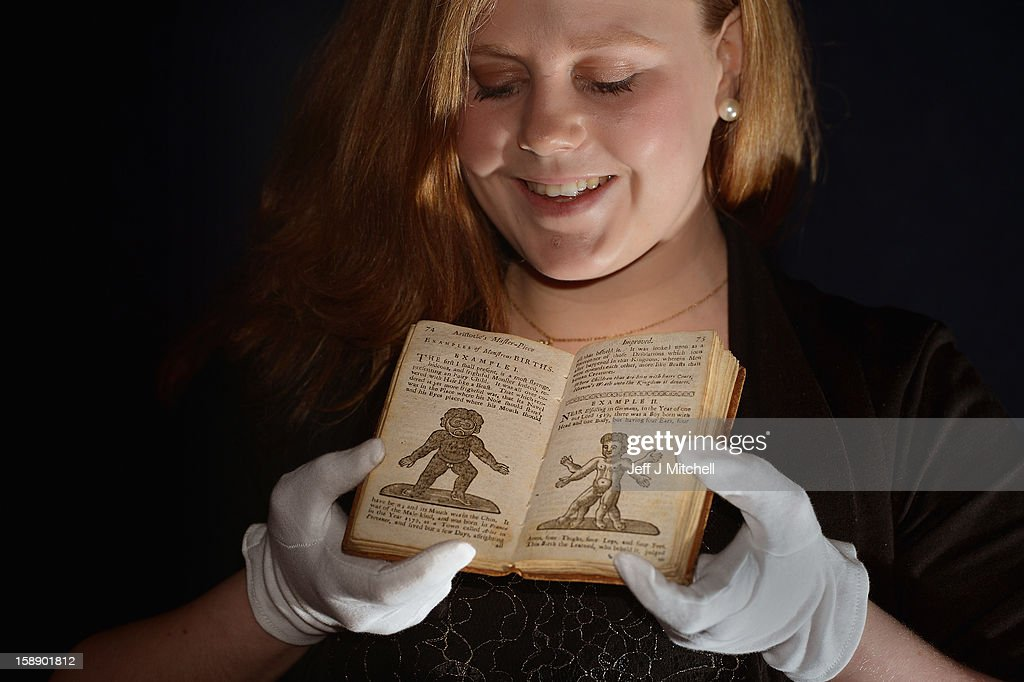 Cathy Marsden, Book Specialist at Lyon & Turnbull, holds a copy of the once-banned book titled 'Aristotle's Compleat Master-Piece' ahead of its January auction at Lyon & Turnbull on January 3, 2012 in Edinburgh, Scotland. A 1760 edition of the book, which first appeared around 1680 and was banned from sale in the UK until the 1960s, is due for auction at Lyon & Turnbull's book sale on the 9th January 2013 in Edinburgh. Incorrectly attributed to Aristotle, the book is of unknown authorship.