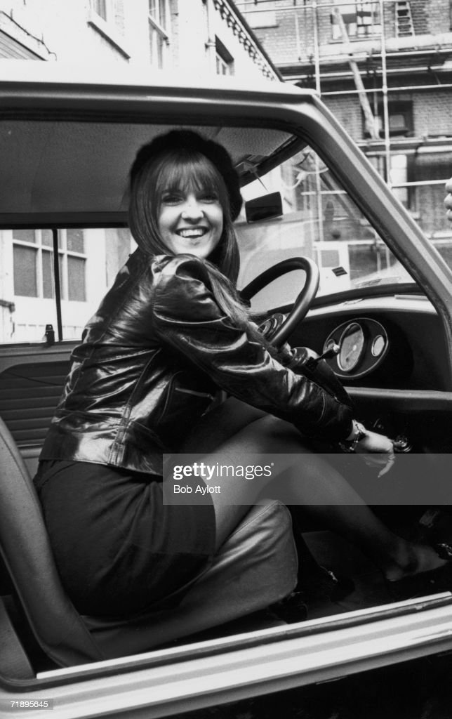 Cathy McGowan, presenter of the TV pop programme 'Ready Steady Go', in her new Mini deluxe automatic after passing her driving test at the first attempt, 19th January 1968.