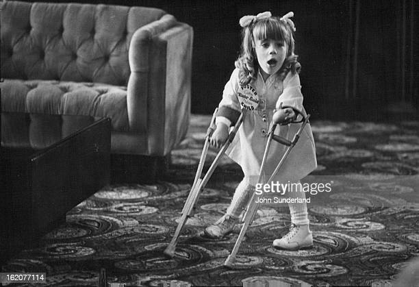 APR 20 1981 Cathy Nelson 1981 Easter seals poster child holds out an egg to show her mother what she had found during Easter egg hunt in lobby of...