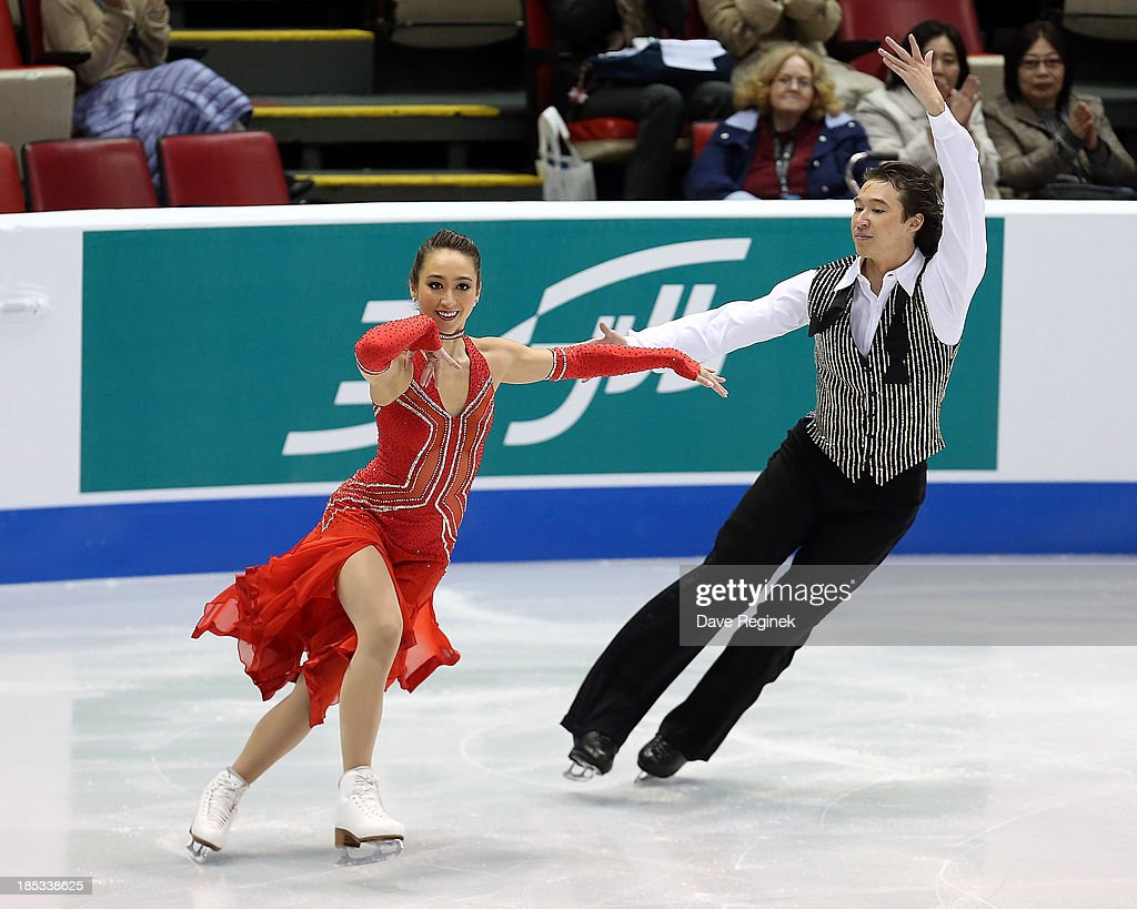 Cathy Reed (L) and Chris Reed of Japan perform during the ice dance short program at Skate America at Joe Louis Arena on October 18, 2013 in Detroit, Michigan.