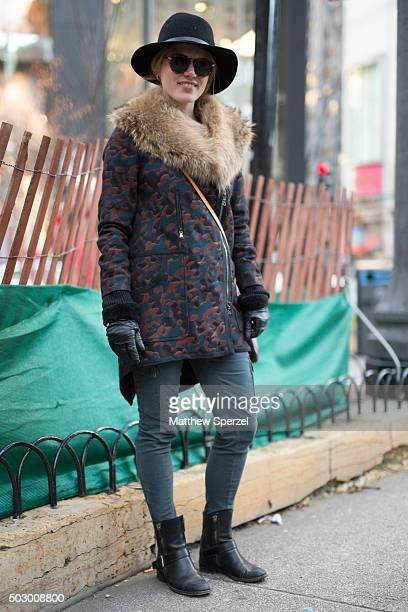 Catie Fretter is seen on Michigan Avenue wearing a black Rag Bone hat patterned cotton/rabbit Veronica Beard coat light blue/green Free People pants...