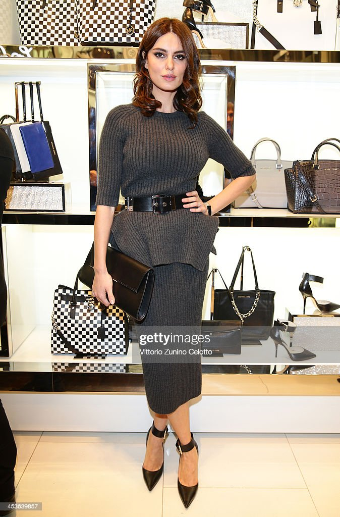 Catrinel Marlon attends Michael Kors To celebrate Milano opening on December 4, 2013 in Milan, Italy.