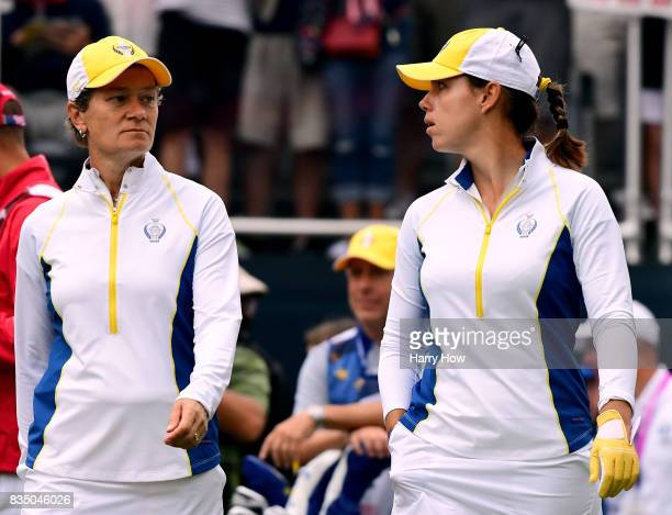 Catriona Matthew and Karine Icher leave the first tee during the morning foursomes matches of the Solheim Cup at the Des Moines Golf and Country Club...