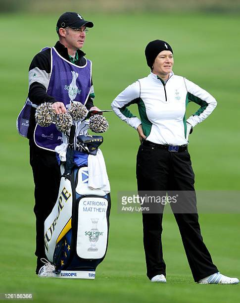 Catriona Matthew of Europe looks on with husband and caddie Graeme during the morning foursomes on day one of the 2011 Solheim Cup at Killeen Castle...