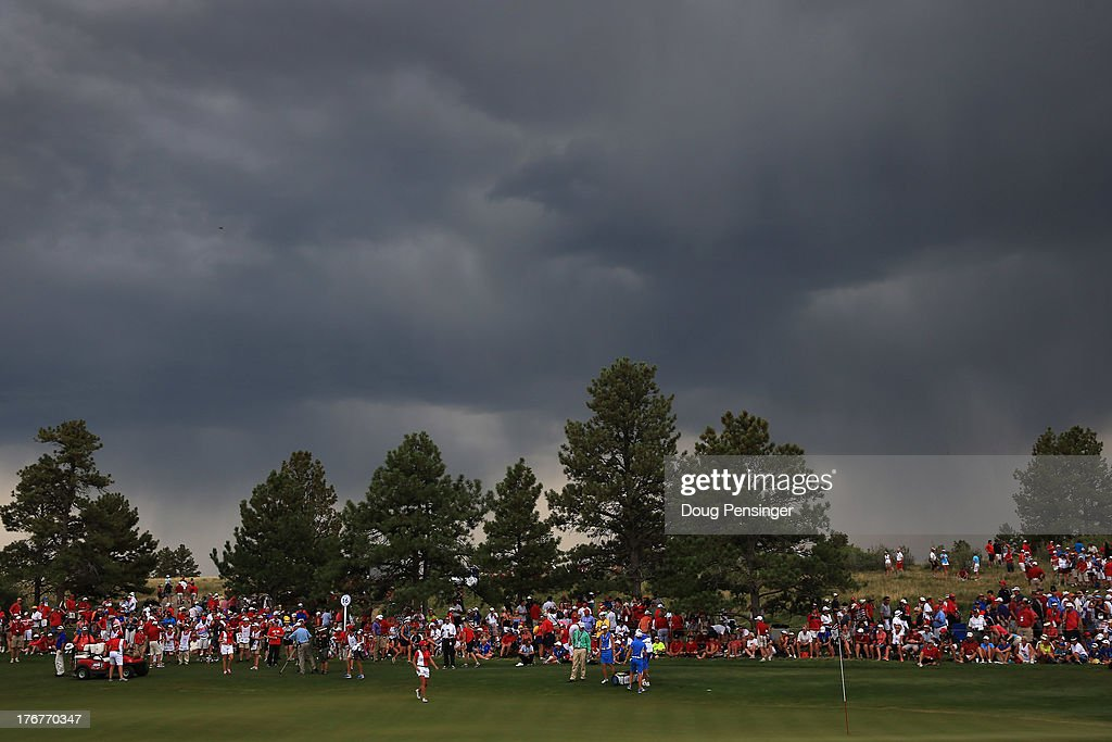 Catriona Matthew of Scotland and the European Team and Gerina Piller of the United States Team are on the 16th green as play in suspended due to lightning during the final day singles matches of the 2013 Solheim Cup on August 18, 2013 at the Colorado Golf Club in Parker, Colorado.
