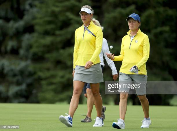 Catriona Matthew of Scotland and the European Team assistant captain walking with Suzann Pettersen of Norway and the European Team who did not play...