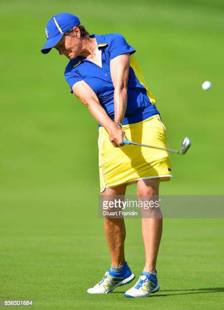 Catriona Matthew of Team Europe plays a shot during the final day singles matches of The Solheim Cup at Des Moines Golf and Country Club on August 20...