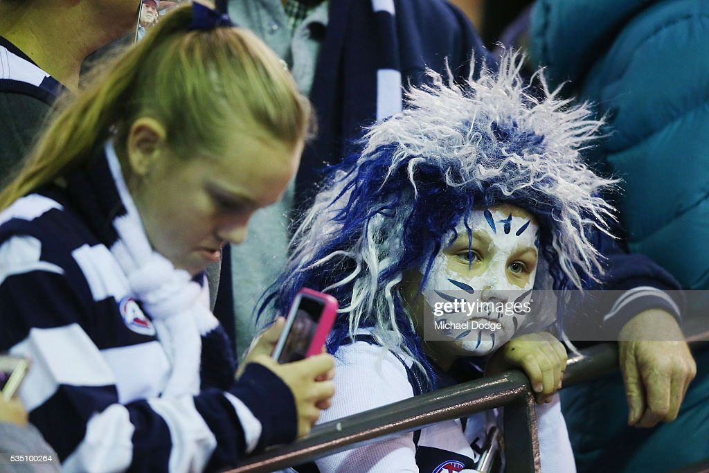 A Cats fan shows her support during the round 10 AFL match between the Carlton Blues and the Geelong Cats at Etihad Stadium on May 29, 2016 in Melbourne, Australia.
