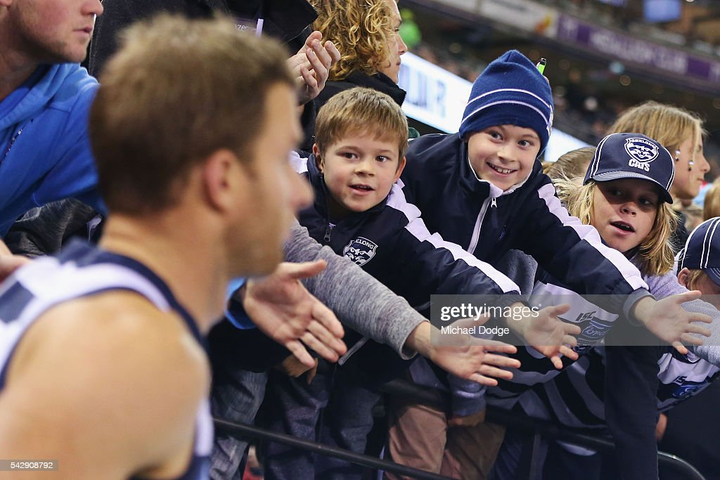 Cats fans greet players during the round 14 AFL match between the St Kilda Saints and the Geelong Cats at Etihad Stadium on June 25, 2016 in Melbourne, Australia.