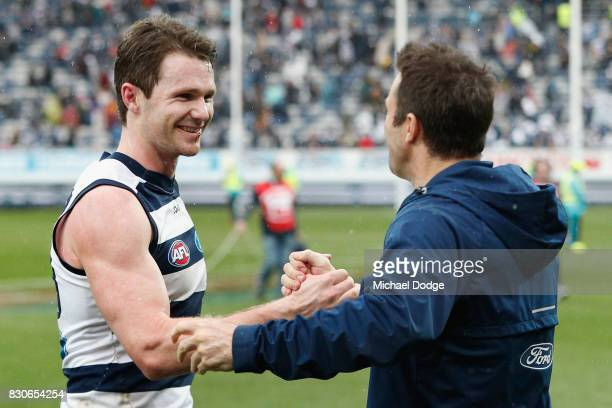 Cats head coach Chris Scott shakes hands with Patrick Dangerfield of the Cats after winning during the round 21 AFL match between the Geelong Cats...