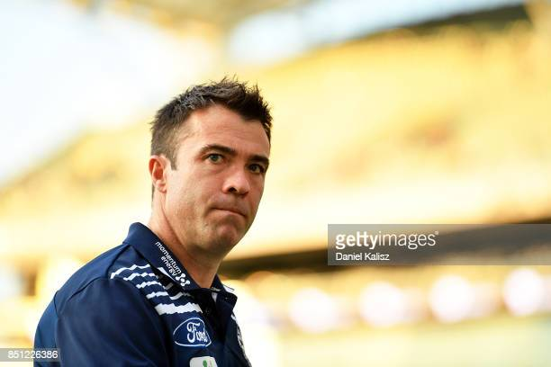 Cats head coach Chris Scott walks from the field prior to the First AFL Preliminary Final match between the Adelaide Crows and the Geelong Cats at...