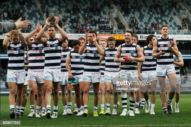 Cats players celebrates the win during the round 21 AFL match between the Geelong Cats and the Richmond Tigers at Simonds Stadium on August 12 2017...