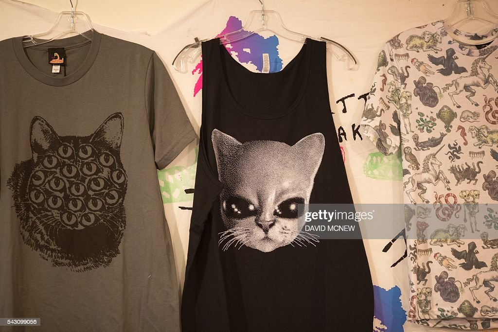 Cat-themed clothing is displayed at CatConLA, a convention to show cat-related products and ideas in art, design, and pop culture, on June 25, 2016 in Los Angeles, California. / AFP / DAVID
