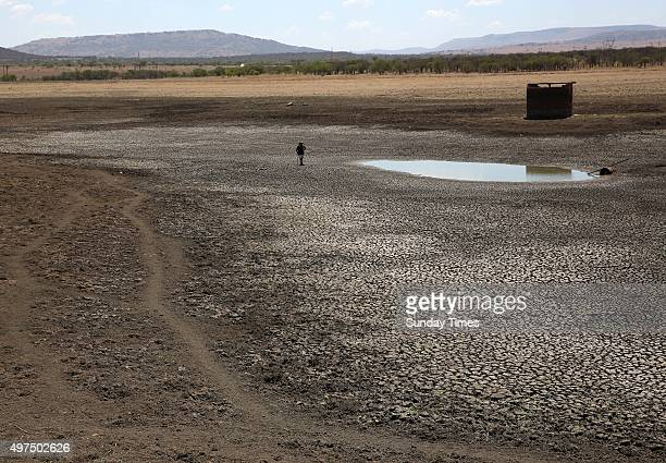 Cattle farmer Owen Geekie stands next to a remaining puddle of what used to be his 200 000 cubic metre dam on November 11 2015 in Ladysmith South...