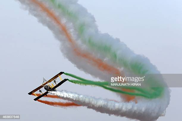 Catwalk or Skycats of the Scandinavian Aerobatic Team leave a trail of Indian tricolour smoke as they perform aerobatics during the second day of the...