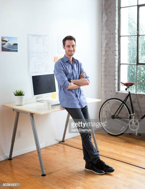 Caucasian architect smiling in office