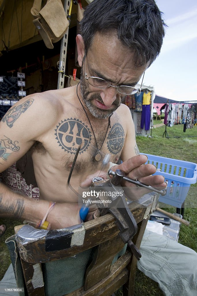 Caucasian artist making jewellery, Solfest, Cumbria UK : Stock Photo