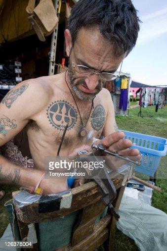 Caucasian artist making jewellery, Solfest, Cumbria UK : Stock Photo