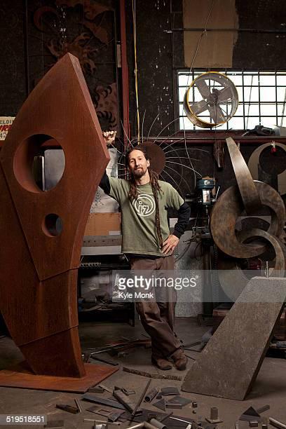 Caucasian artist standing in studio