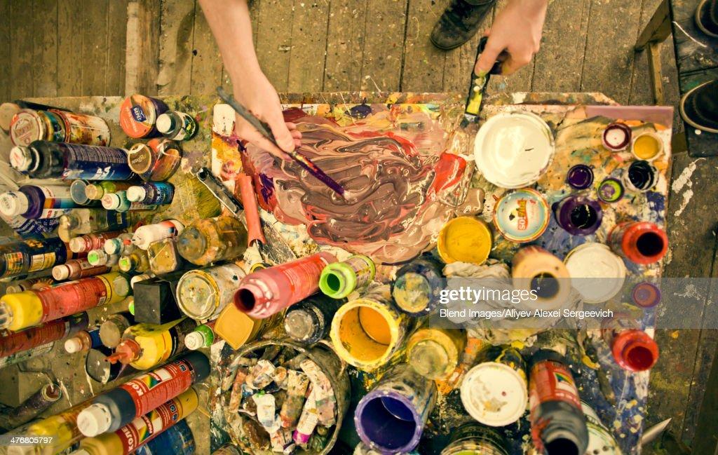 Caucasian artist working in studio : Stock Photo