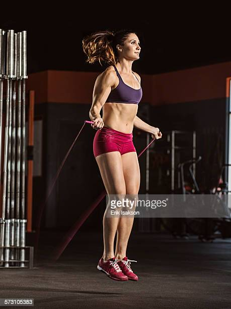 Caucasian athlete jumping rope in gym