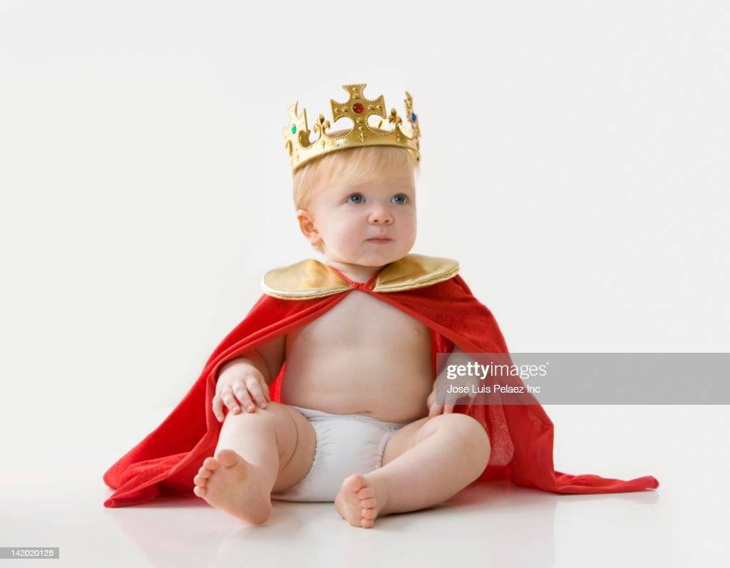 Caucasian baby boy dressed as king : Stock Photo