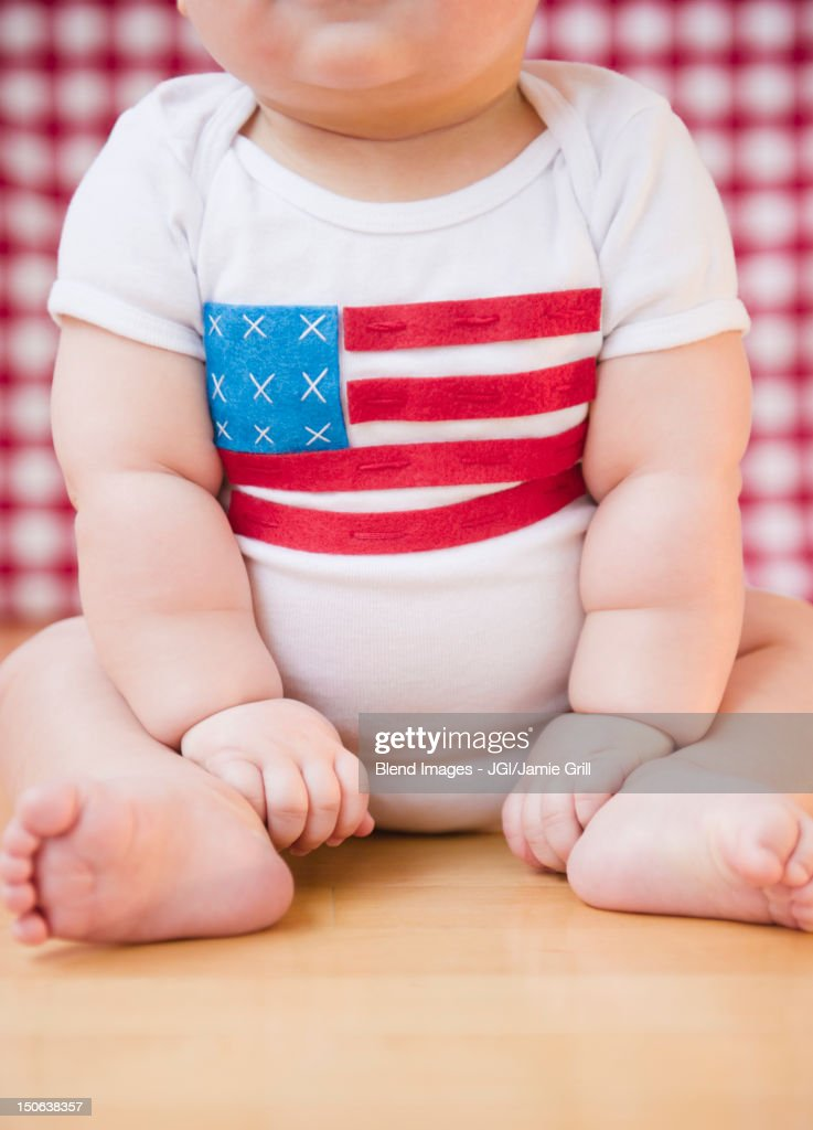 Caucasian baby boy in onesie with American flag on it : Stock Photo