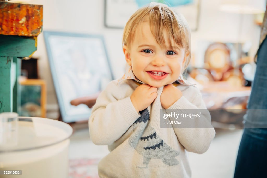 Caucasian baby boy smiling in living room