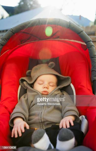 Caucasian baby sleeping in car seat