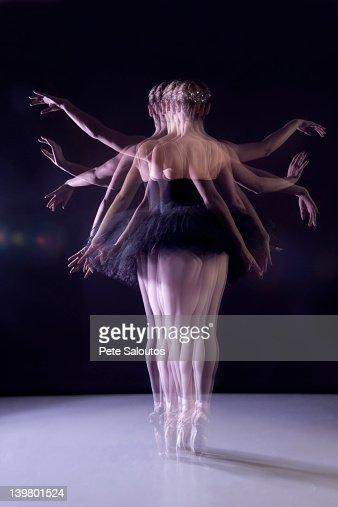 Caucasian ballerina dancing on stage : Stock Photo