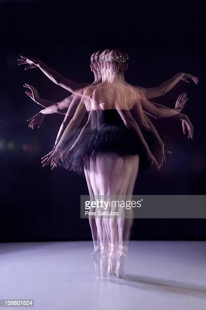 Caucasian ballerina dancing on stage