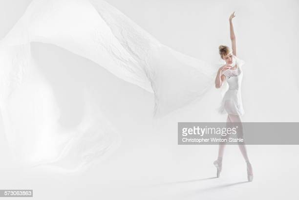Caucasian ballet dancer dancing on pointe