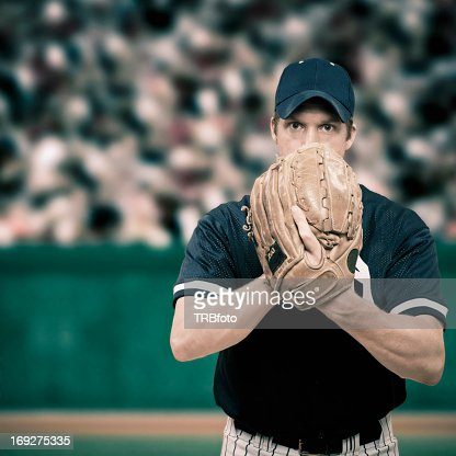 Caucasian baseball player holding glove