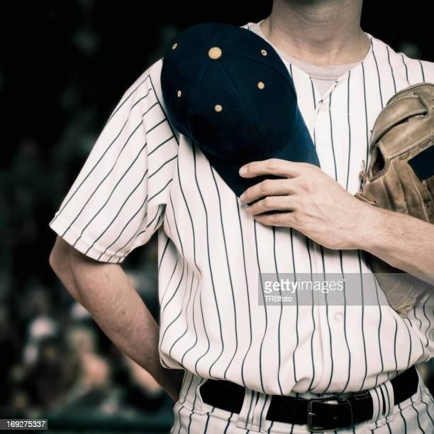 Caucasian baseball player holding hat over heart