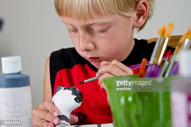 Caucasian Blond Little Boy Painting Pottery