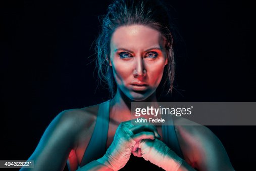 Caucasian boxer cracking her knuckles