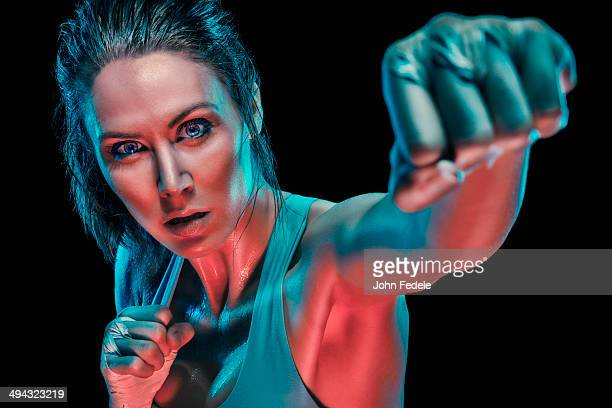 Caucasian boxer in fighting stance