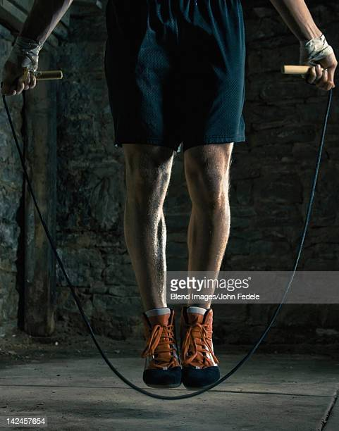 Caucasian boxer training and jumping rope