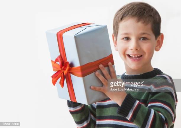 Caucasian boy holding gift
