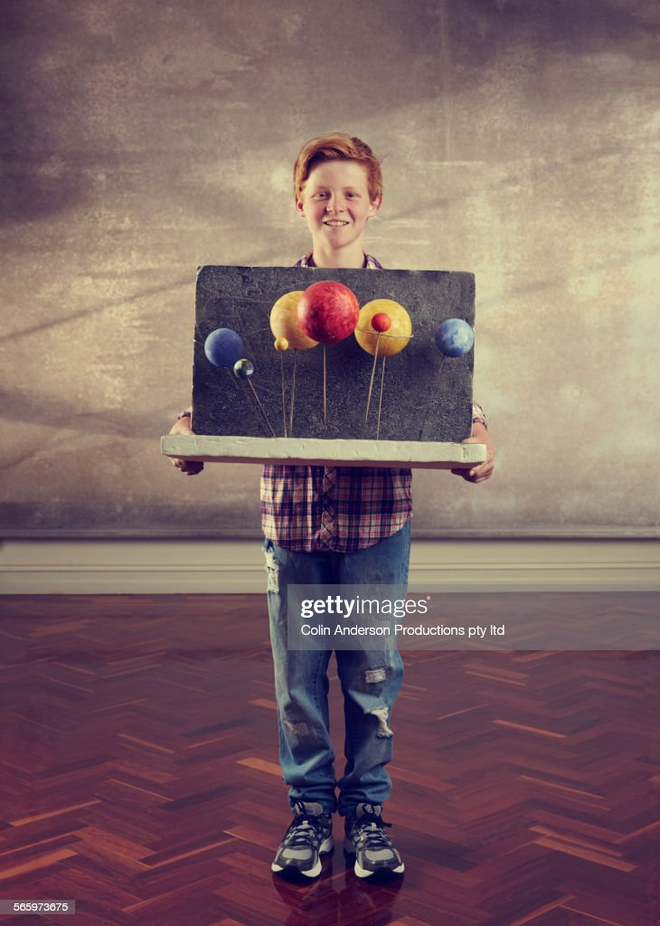 Caucasian boy holding science diorama : Foto stock