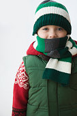 Caucasian boy in cap and scarf