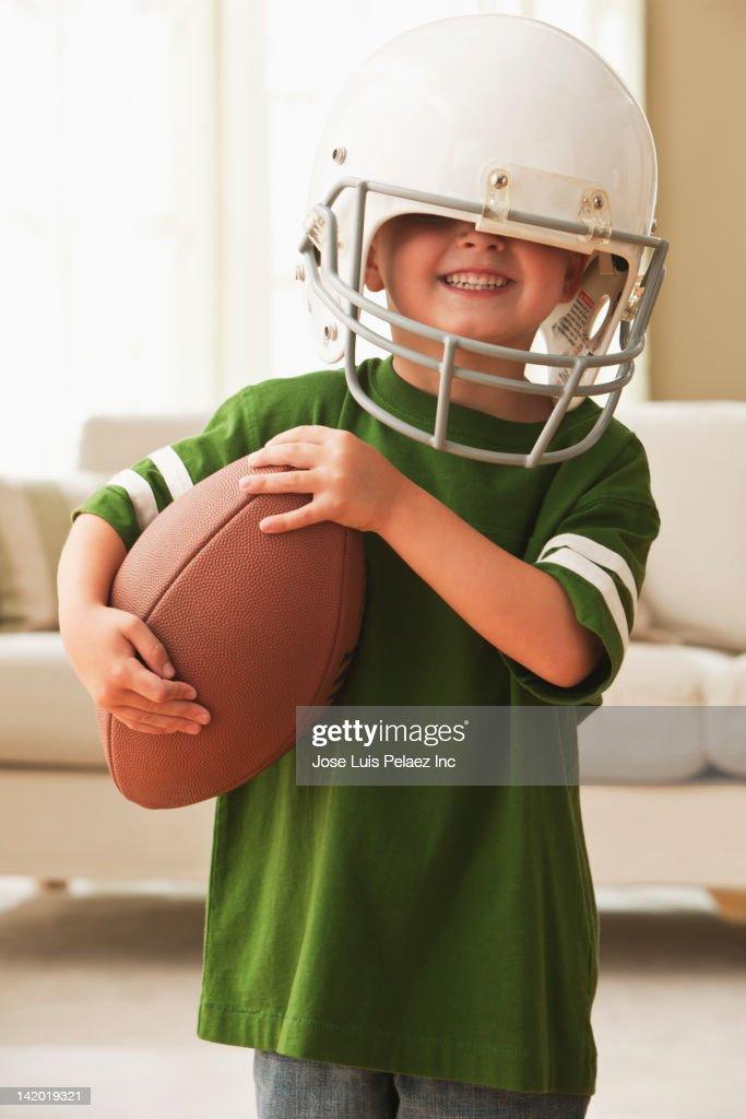 Caucasian boy in football uniform