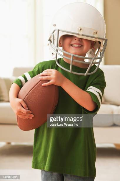 Caucasian boy in football uniform