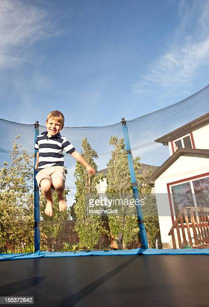 Caucasian Boy Jumping on Trampoline