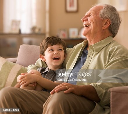Caucasian boy laughing with grandfather