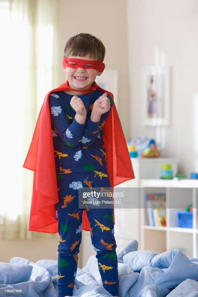 Caucasian boy playing in superhero costume : Stock Photo