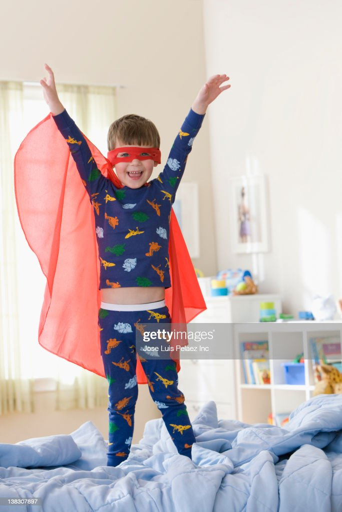Caucasian boy playing in superhero costume : Stock Photo